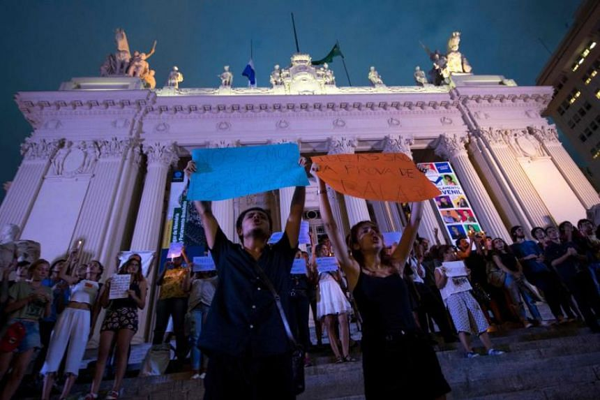 Demonstrators shout slogans during a protest against the murder of Brazilian councilwoman and activist Marielle Franco in Rio de Janeiro on March 16, 2018.