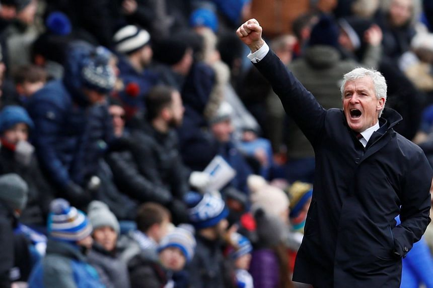 Southampton manager Mark Hughes celebrating after Cedric Soares scores their second goal against Wigan in their FA Cup quarter-final at the DW Stadium on March 18, 2018.