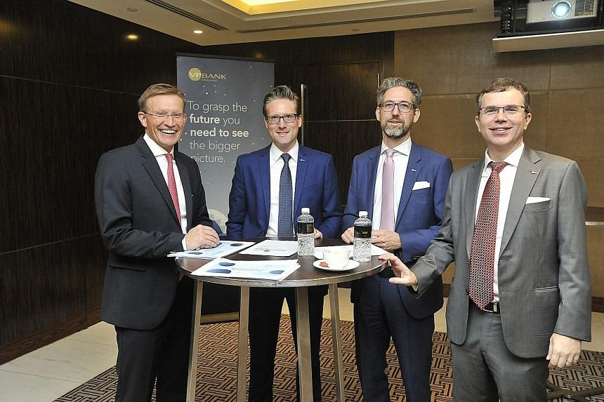 (From left) VP Bank's head of client business Christoph Mauchle, Singapore's head of investment advisory and treasury Asia Thomas Rupf, chief strategist and head of investment research Bernd Hartmann, and Singapore chief executive Bruno Morel.
