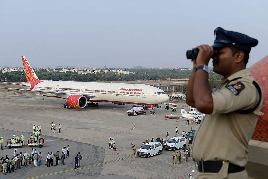 An Air India plane on the tarmac during an airshow at Begumpet Airport in Hyderabad. The Sydney-based Centre for Aviation estimates that India needs to invest US$45 billion (S$59 billion) by 2030 to keep up with air travel demand.