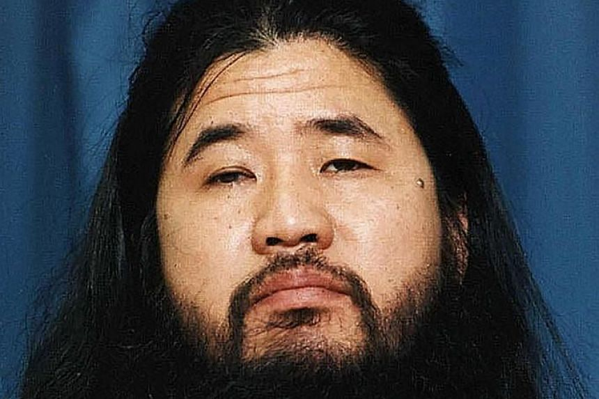 A file photo taken in October 1990 of doomsday cult guru Shoko Asahara.