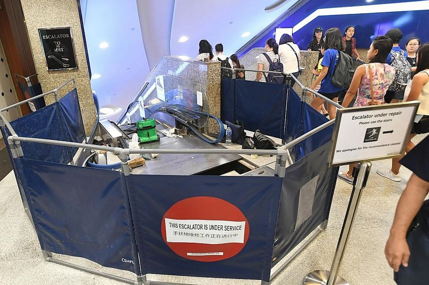 """Six passers-by went to the aid of a woman whose arm was reportedly caught in a gap between this escalator and a wall in Bugis Junction. They """"grabbed the railing and pulled as hard as possible"""" till the glass panel shattered."""