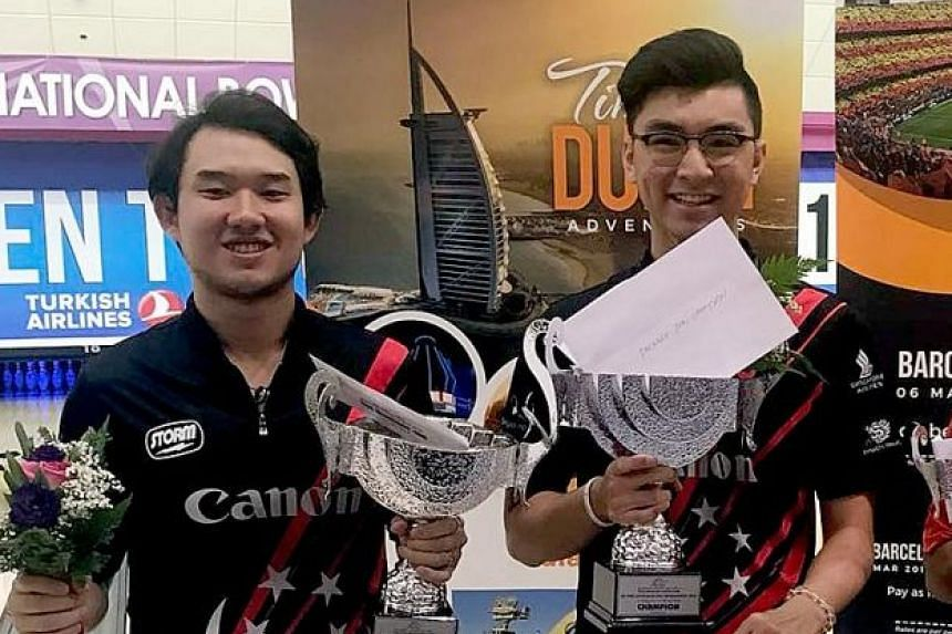 Runner-up Muhd Jaris Goh (left) and champion Jonovan Neo, both of Singapore, with their trophies.