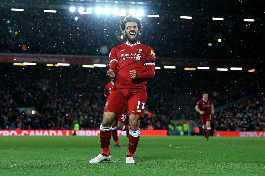 Mohamed Salah is ecstatic after his fourth goal against Watford moved him four clear of Harry Kane in the race for the Premier League's Golden Boot. The Egyptian, who has 28 in the league this season, also set up Roberto Firmino for Liverpool's third