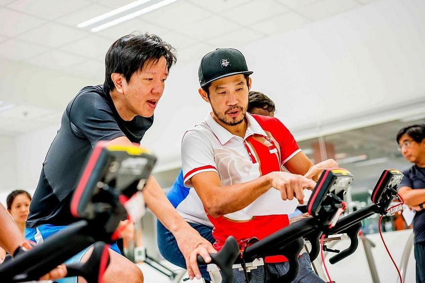 Singapore Cycling Federation head coach Adrian Ng (right) leads a conditioning session before the OCBC Cycle last year.