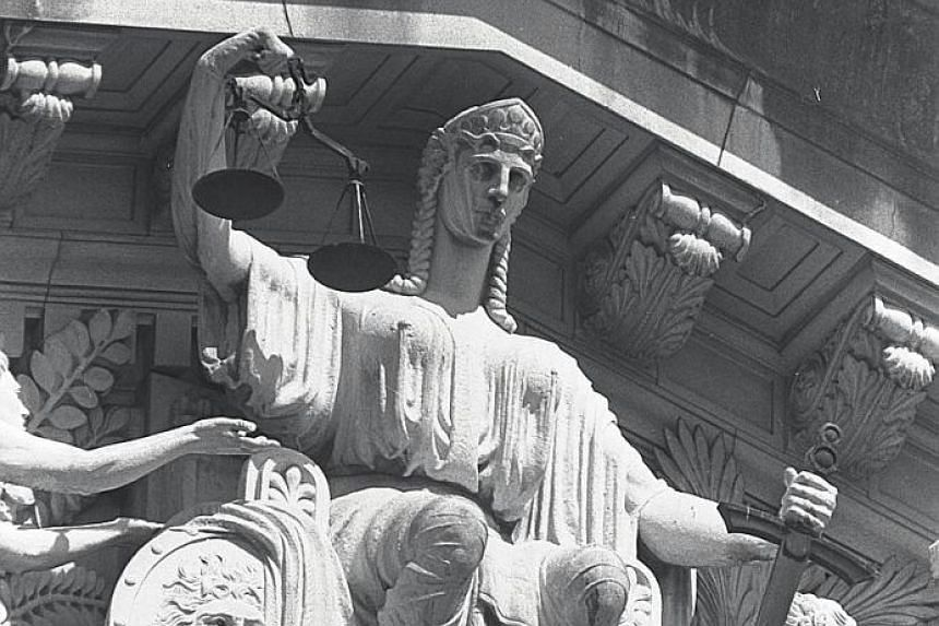 A statue of Justice holding the scales outside the old Supreme Court building. The writer says that giving a fair hearing to accused persons benefits the public, as it increases confidence that the courts are convicting the guilty and acquitting the