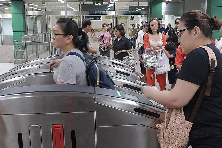 Commuters at Novena station on the North-South line. The decline in ridership on the two oldest MRT lines last year reversed an almost continuous upward trend seen since the lines opened 30 years ago.
