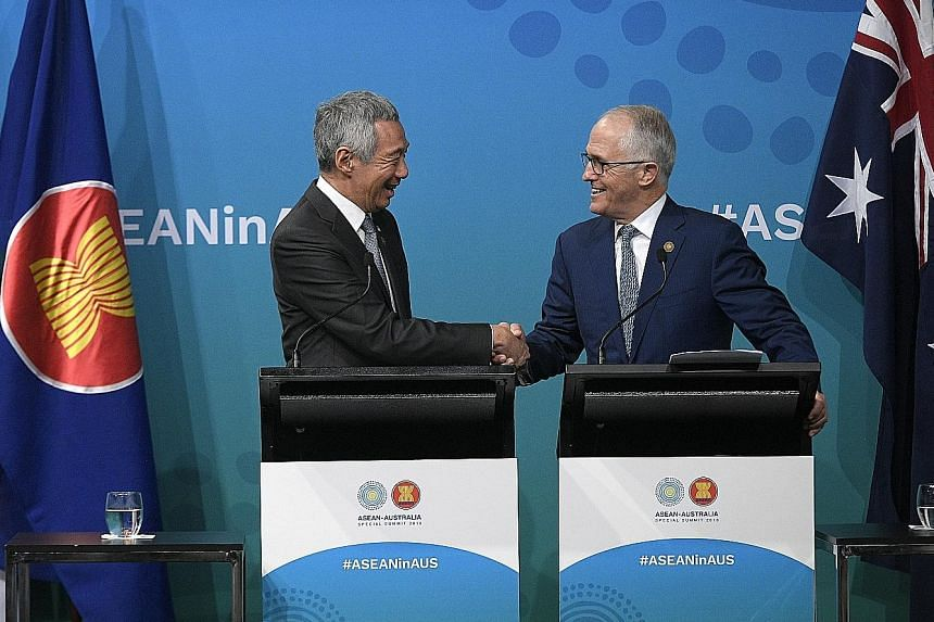 Prime Minister Lee Hsien Loong and Australian Prime Minister Malcolm Turnbull at a joint press conference at the close of the Asean-Australia Special Summit in Sydney yesterday.
