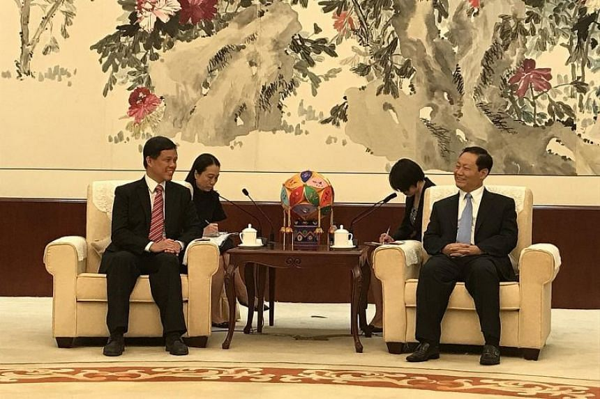 Minister in the Prime Minister's Office Chan Chun Sing with Guangxi party boss Peng Qinghua in Nanning on Sept 1, 2017.