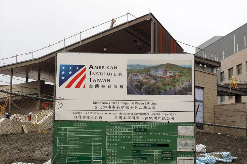 A signboard stands at the site of the new American Institute in Taiwan (AIT) compound in Taipei on March 17, 2018. AIT is the de facto US embassy in Taiwan.