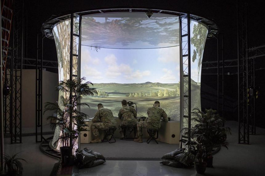 Army fire support specialist trainees in a simulator at Fort Sill, Oklahoma, on Feb 6, 2018.