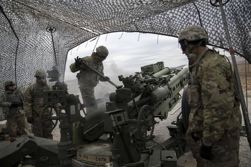Soldiers train on a howlitzer during a live-fire exercise at Fort Sill, Oklahoma.