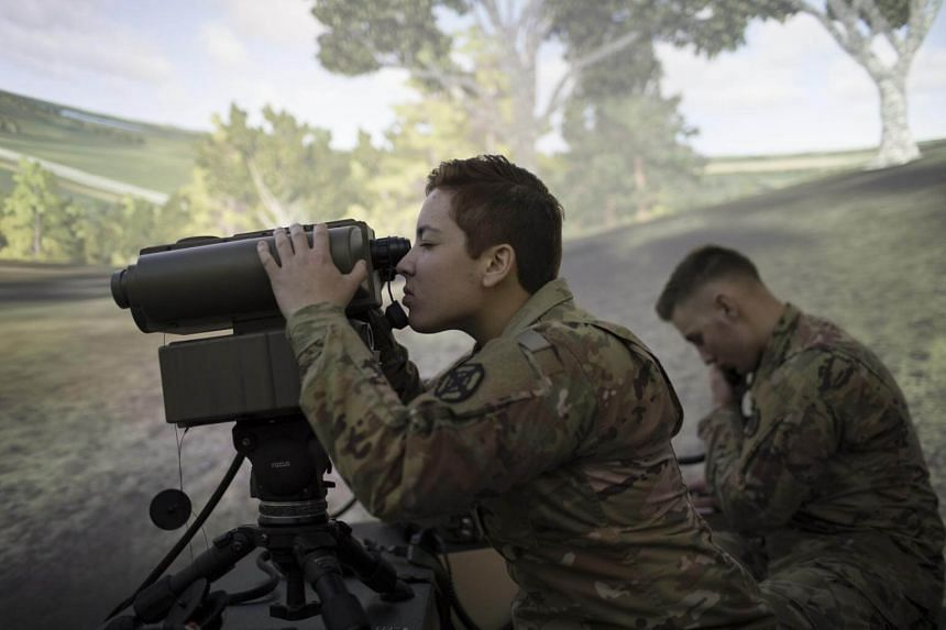 Private Emily Castillo, a fire support specialist trainee, uses a close air support module in a simulator.