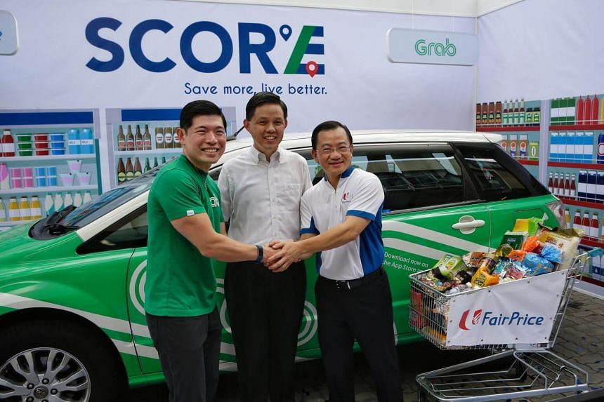 (From left) Grab Group CEO and co-founder Anthony Tan, NTUC secretary-general Chan Chun Sing and NTUC Fairprice CEO Seah Kian Peng posing at the Score subscription programme, on March 19, 2018.
