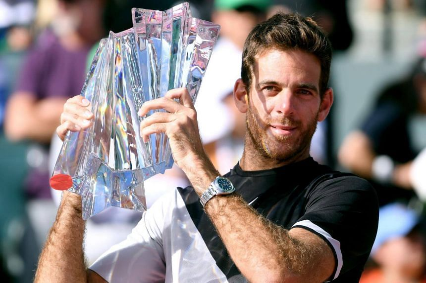 Juan Martin Del Potro poses with the trophy after his victory over Roger Federer in the ATP final during the BNP Paribas Open at the Indian Wells Tennis Garden in California, on March 18, 2018.