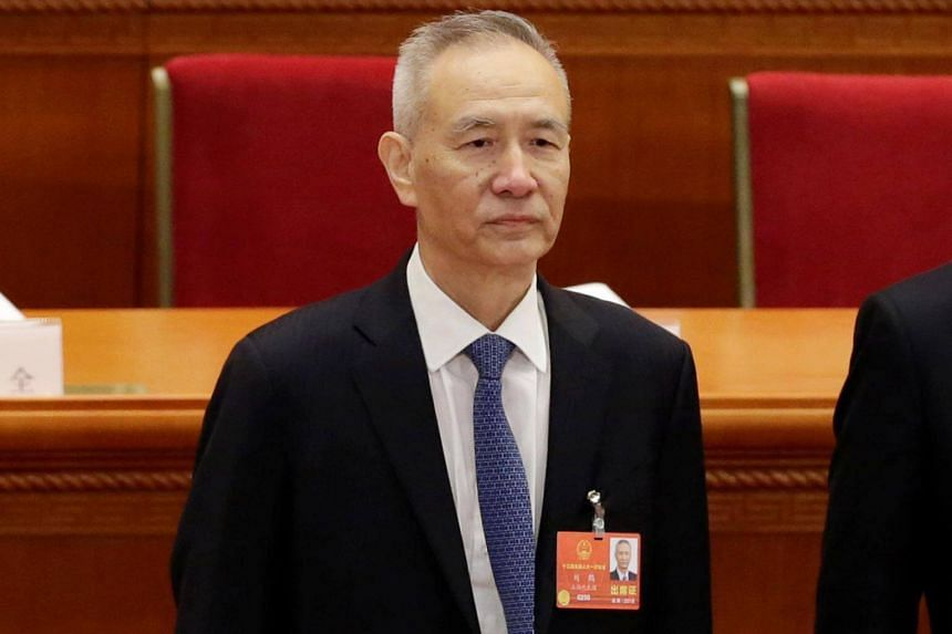 Mr Liu He arrives for the opening session of the National People's Congress (NPC) at the Great Hall of the People, on March 5, 2018.