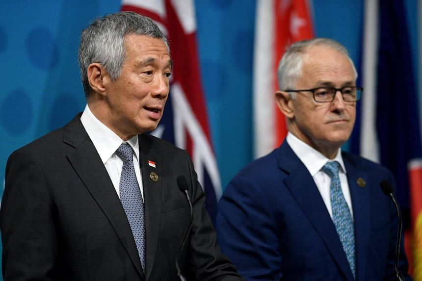 PM Lee Hsien Loong (left) and Australian PM Malcolm Turnbull (right) attend a joint press conference at the close of the Asean-Australia Special Summit, in Sydney, on March 18, 2018.