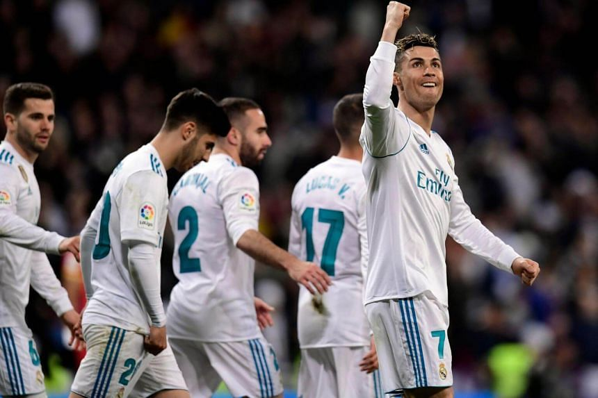 Real Madrid's Portuguese forward Cristiano Ronaldo celebrates a goal during the Spanish League football match between Real Madrid and Girona at the Santiago Bernabeu stadium in Madrid on March 18, 2018.