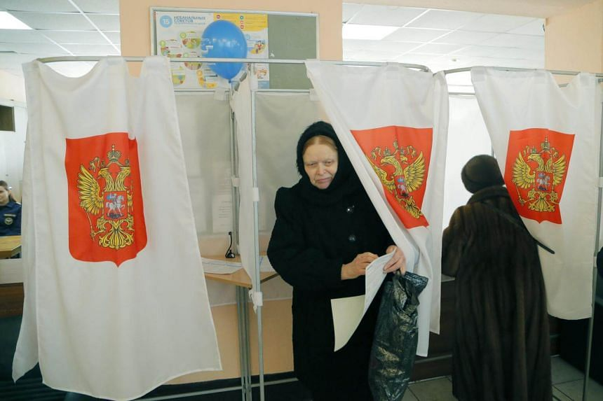 Citizens voting in the Russian presidential elections at a polling station in Moscow, Russia, on March 18, 2018.