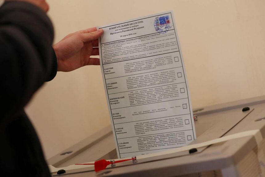 A man votes during the presidential election inside the Russian Embassy in London, Britain, on March 18, 2018.