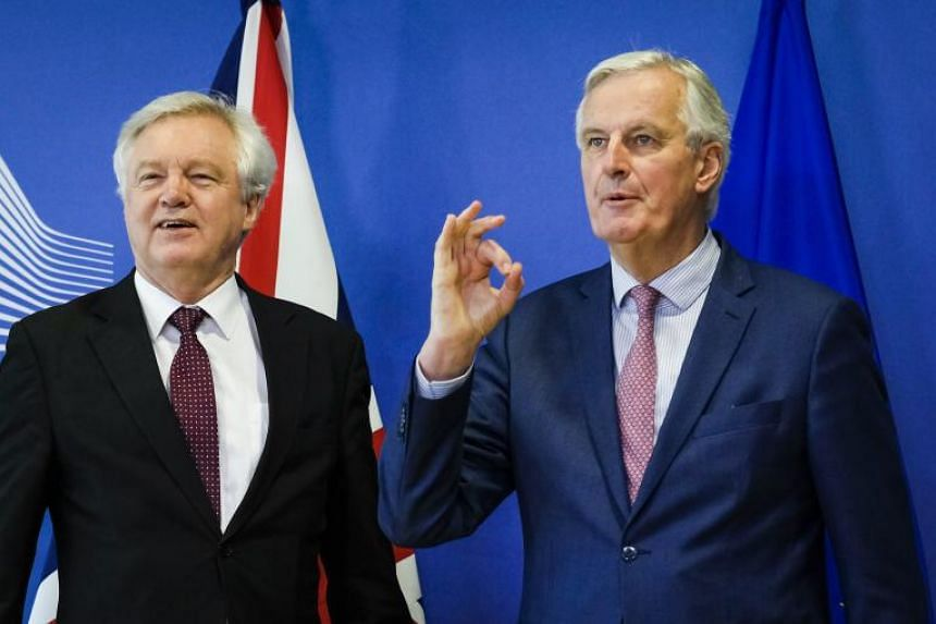 Britain's Secretary of State for Exiting the European Union David Davis and EU negotiator Michel Barnier (right), prior to a meeting in Brussels, on March 19, 2018.