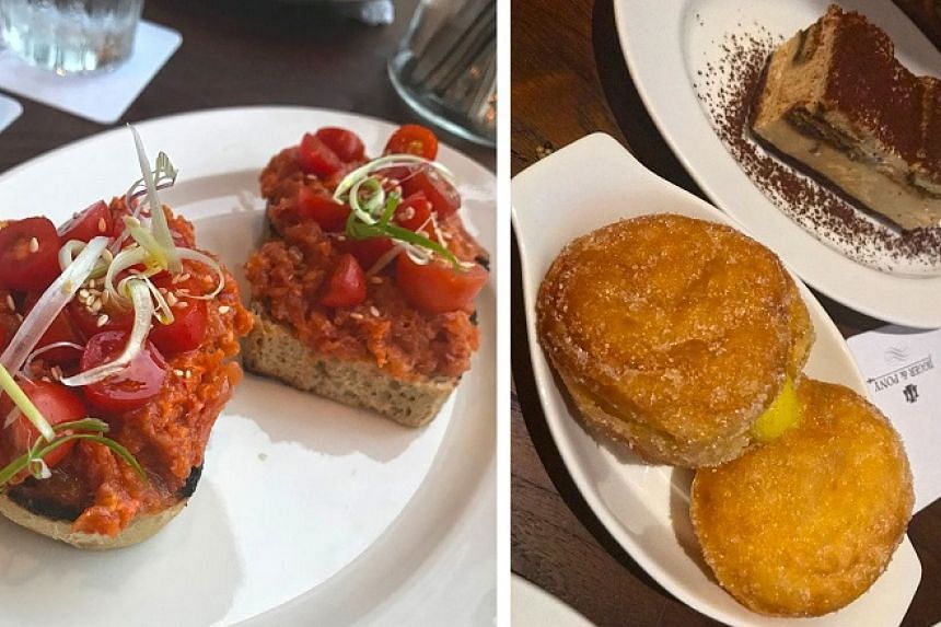 From left: Raw tuna is minced and then obliterated with the strong, dominant nduja chilli paste (S$17) on crunchy sourdough toast; the bombolini ($13) is cold and oily, oozing lemon curd in an almost off-putting way; and the tiramisu ($15), served li