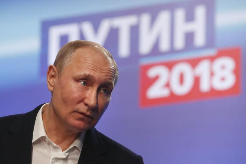 Russian President-elect Vladimir Putin attends a press conference after his visit to his staff at his campaign headquarters in Moscow, Russia, on March 18, 2018.