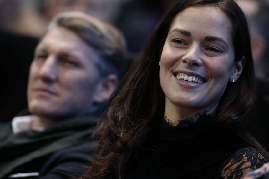 This file photo taken on Nov 20, 2016 shows Serbia's Ana Ivanovic and then Manchester United's German footballer Bastian Schweinsteiger watching the men's singles final of the ATP World Tour Finals tennis tournament.