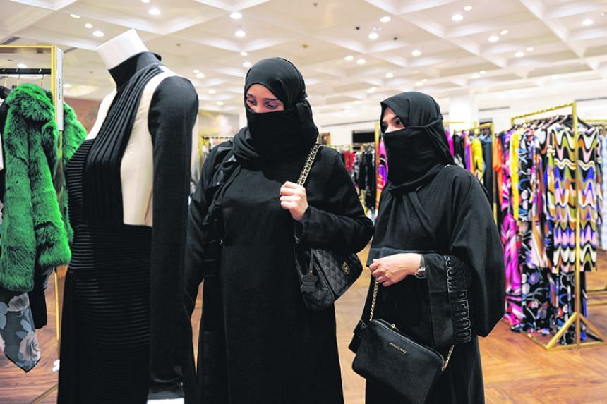 Saudi women check the new collection at an upmarket clothing boutique in Jeddah on Nov 28, 2017.