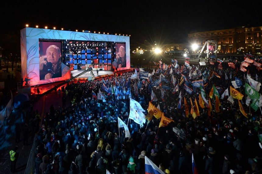 Vladimir Putin speaking to his supporters during a rally at Manezhnaya Square near the Kremlin in Moscow, Russia, on March 18, 2018.