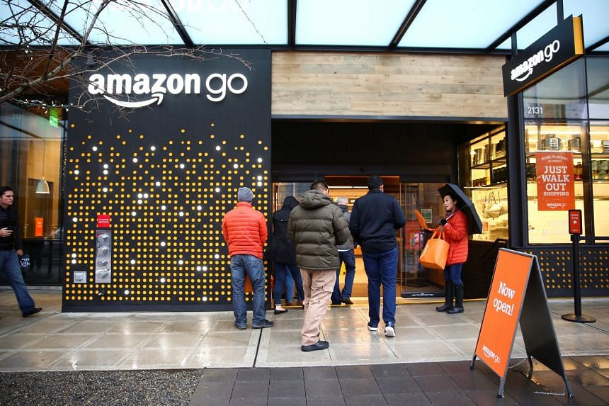 People entering the new Amazon Go store at Amazon's Seattle headquarters in Seattle, Washington, US, on Jan 29, 2018.