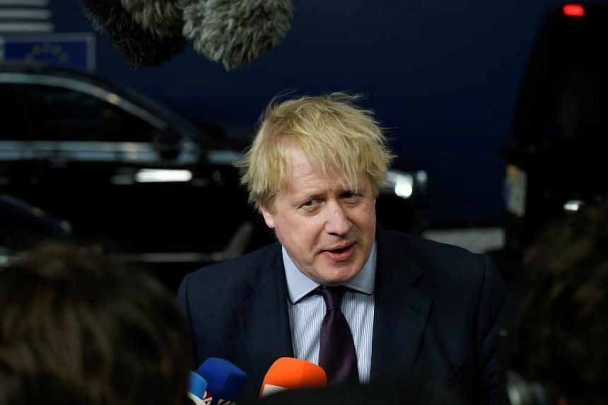 British foreign minister Boris Johnson addresses reporters as he arrives ahead of a foreign affairs minister meeting at the European Union headquarters in Brussels on March 19, 2018.