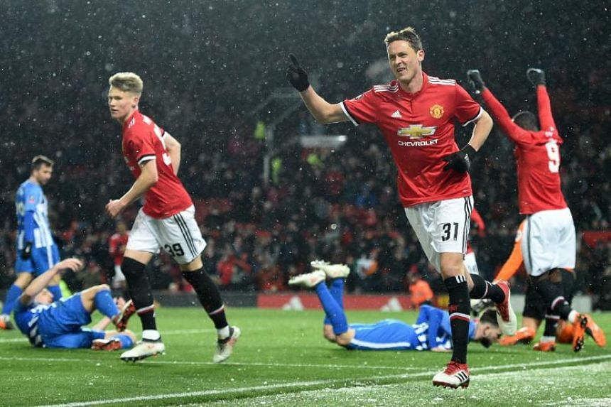 Manchester United midfielder Nemanja Matic celerates scoring the team's second goal during the English FA Cup quarter-final match against Brighton and Hove Albion at Old Trafford in Manchester on March 17, 2018.