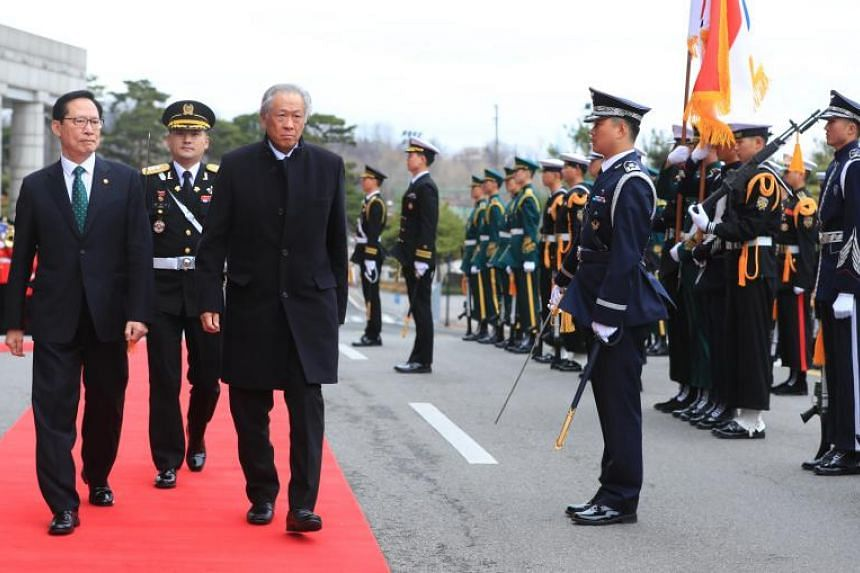 Minister for Defence Ng Eng Hen with his South Korean counterpart, Mr Song Young Moo, at a welcome ceremony in Seoul, South Korea on March 19, 2018.