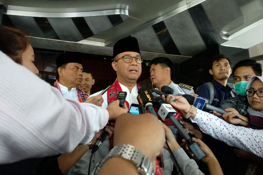Jakarta Governor Anies Baswedan speaks to journalists after his meeting with Bank Indonesia Governor Agus Martowardojo at the central bank's Jakarta headquarters on Jan 5, 2018.