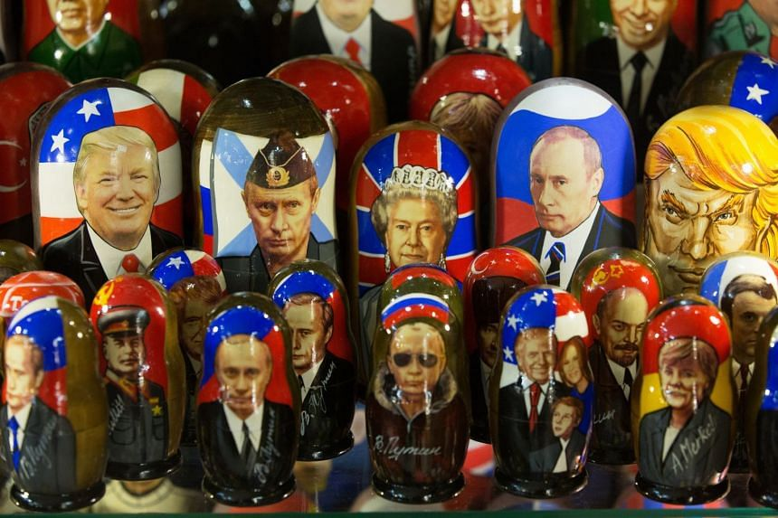 A Moscow gift shop displays matryoshka dolls decorated with the faces of Vladimir Putin and Donald Trump, among others.
