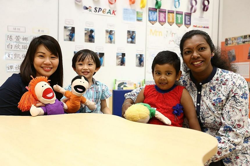 Madam Rachel Ong with her son Lukas Liew and Mrs Mohanraj Vasantharany with her daughter Akshekha Mohanraj at the MOE kindergarten at West Spring Primary School. Madam Ong is willing to move her son from a private kindergarten to the MOE kindergarten