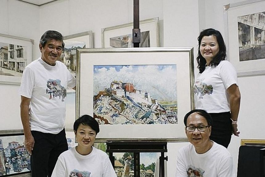 Artist Ong Kim Seng (left, standing) with his students, (anti-clockwise from front left) graphic designer and art teacher Alicia Tan, 45; semi-retired builder Tham Kum Yuen, 64; and Annie Lee, 44, who works in the construction industry.
