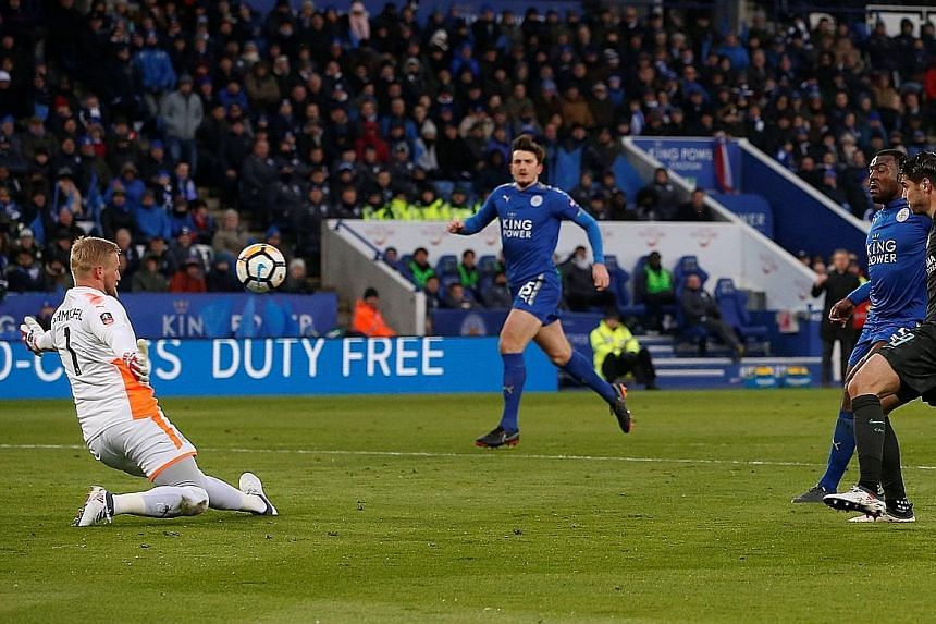 Chelsea's Alvaro Morata scoring their first goal past Leicester goalkeeper Kasper Schmeichel in Sunday's FA Cup quarter-final. Jamie Vardy equalised before Pedro's extra-time header sent the Blues into the semi-finals.