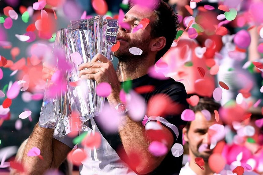 Confetti rains down on Juan Martin del Potro as he holds his trophy after defeating world No. 1 Roger Federer in the final at Indian Wells, California, on Sunday. The Argentinian saved three match points before closing out a 6-4, 6-7 (8-10), 7-6 (7-2