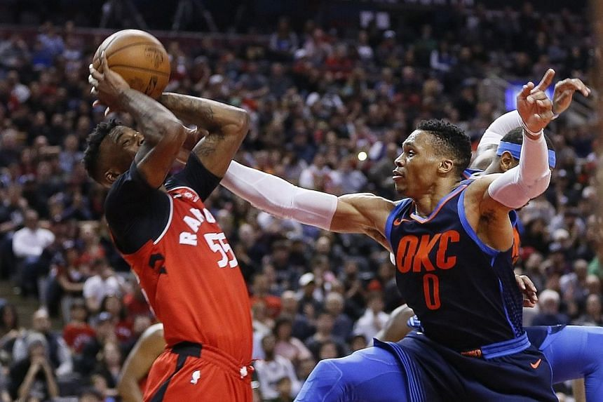 Oklahoma's Russell Westbrook (right), who recorded a fifth straight triple-double, defends against Toronto's Delon Wright during the Thunder's 132-125 victory.