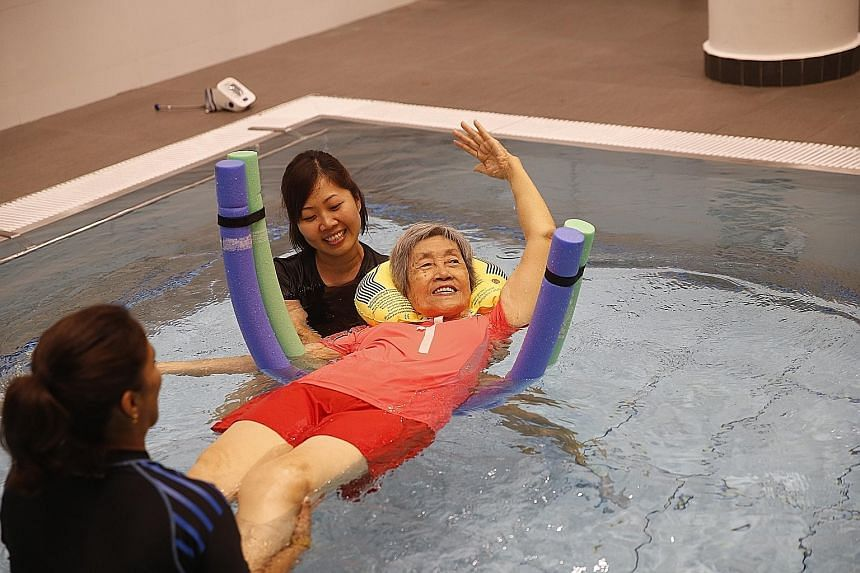 Madam Theresa Lam, who is one of five residents receiving water therapy at St Joseph's Home, feels that it has been beneficial and she can now turn around in bed.