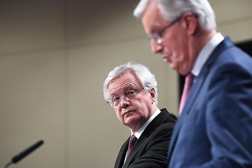 British Brexit minister David Davis (far left) and EU chief negotiator Michel Barnier addressing the media after their meeting at the European Commission in Brussels yesterday. The purpose of the transition period is to give businesses and citizens t