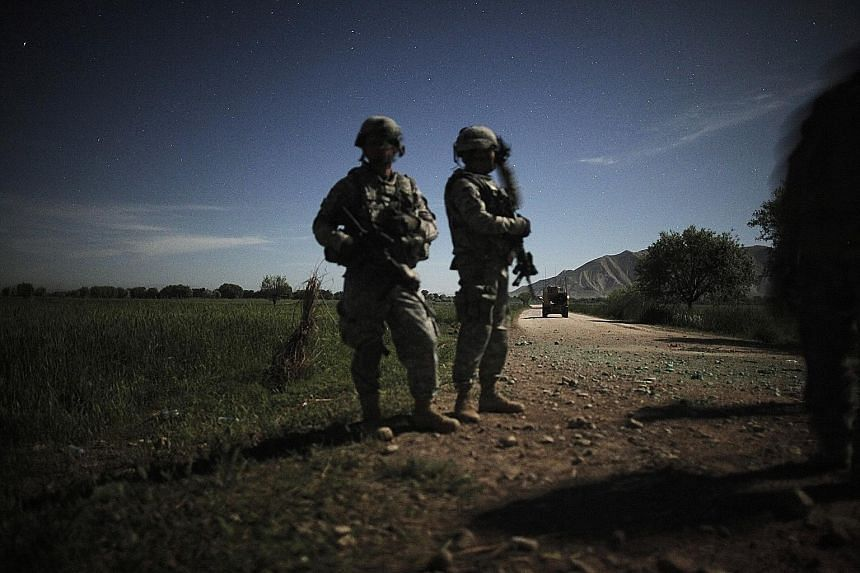 US military quick response soldiers stand guard with night vision goggles in Afghanistan in April 2010. Soldiers in the field still do not have new night vision goggles that could save lives.