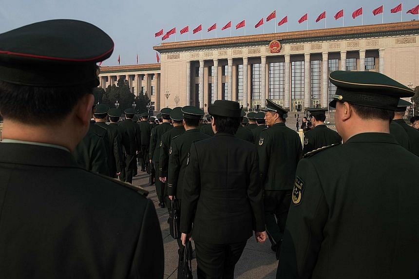 Military delegates arriving for the seventh plenary session of the National People's Congress at the Great Hall of the People in Beijing yesterday. The appointment of General Wei Fenghe as defence minister completed the shake-up of top military offic