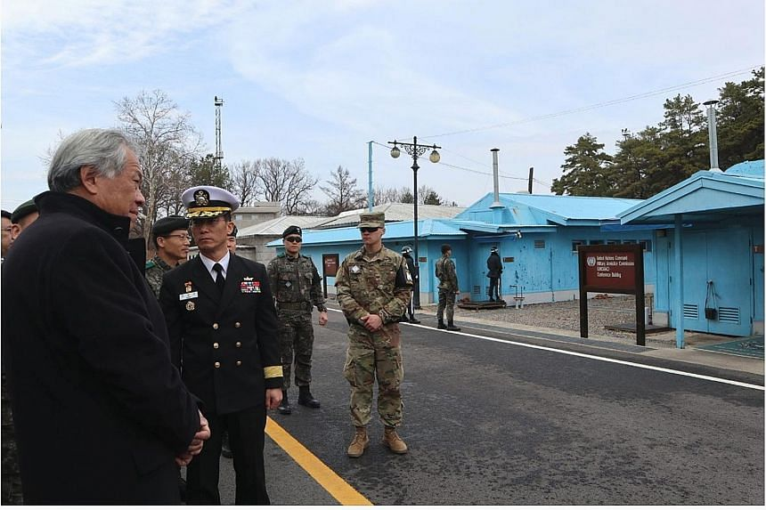 Defence Minister Ng Eng Hen (far left) at the heavily fortified Korean Demilitarised Zone (DMZ) yesterday. The DMZ divides the two Koreas, which are technically in a state of war.