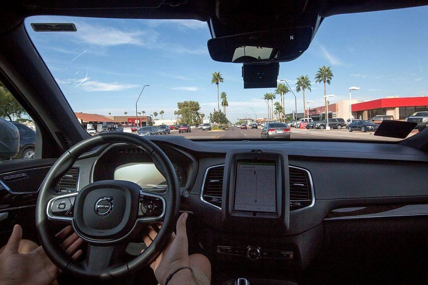 A man operates a self driving Volvo vehicle, purchased by Uber, in Phoenix, Arizona, US on Dec 1, 2017.