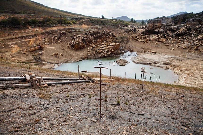 An nearly water empty dam is pictured on a farm in Piket Bo-berg, Piketberg, north of Cape Town, South Africa, as a result of a three-year-long drought.