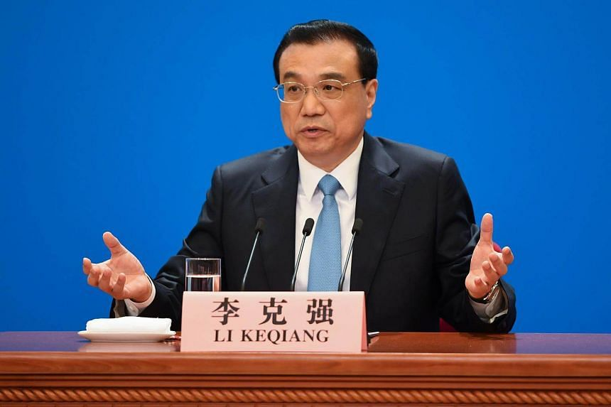 China's Premier Li Keqiang speaks during a press conference after the closing session of the National People's Congress at the Great Hall of the People in Beijing on March 20, 2018.