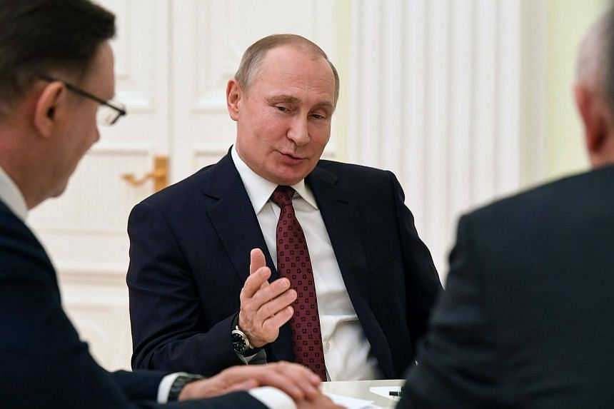 Russian President and presidential candidate Vladimir Putin meets with co-chairs of his campaign at their headquarters in Moscow, on March 19, 2018.